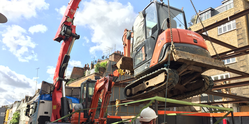 two diggers lifted from london basement