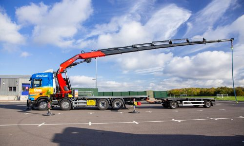 Lorry with crane extended in car park